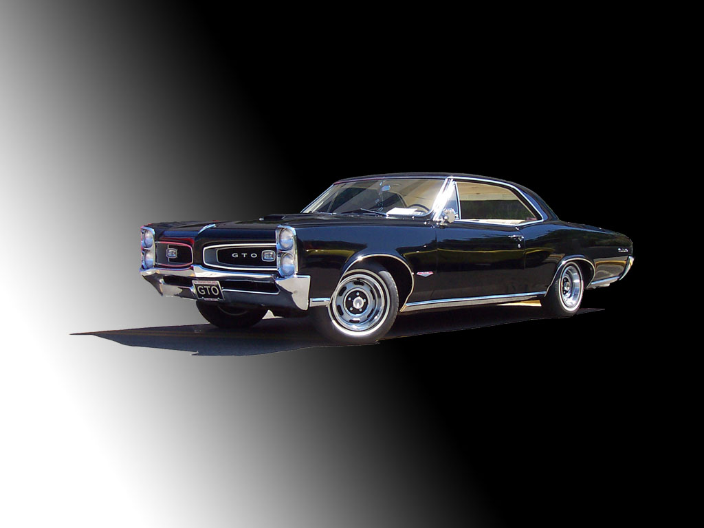 Click image for larger version  Name:1966 Black Pontiac GTO.jpg Views:84 Size:96.1 KB ID:14118