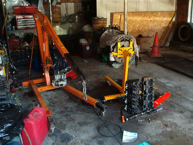 Click image for larger version  Name:garage with hoist and junk.jpg Views:932 Size:66.2 KB ID:3548