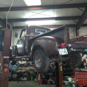 50 CHEVY ON LIFT FOR GAS TANK