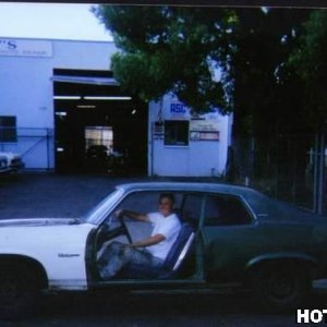 This is me in front of my auto shop